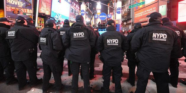 NEW YORK, NY - DECEMBER 31:  Members of the New York City Police Department  attend New Year's Eve 2013 With Carson Daly in T