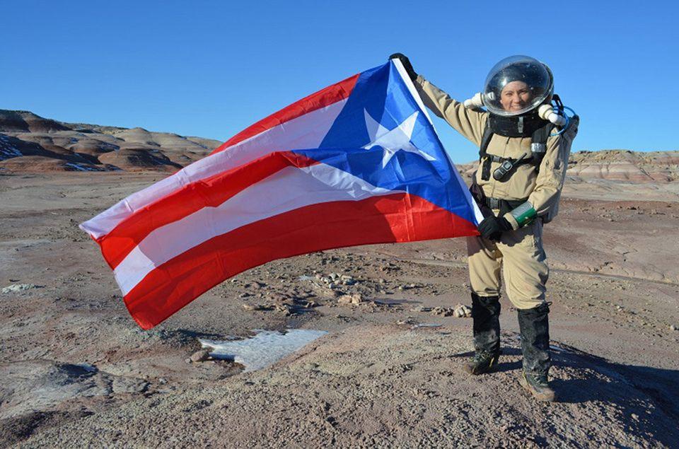 "Dr. Yajaira Sierra-Sastre holding a the Puerto Rican flag. (<a href=""http://hi-seas.org/"">Dr. Sian Proctor</a>)"