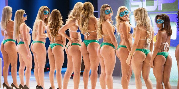 Competitors of 'Miss Bumbum Brasil 2012', the contest for the cutest bottom, wait to record a TV program in Osasco, a surburb