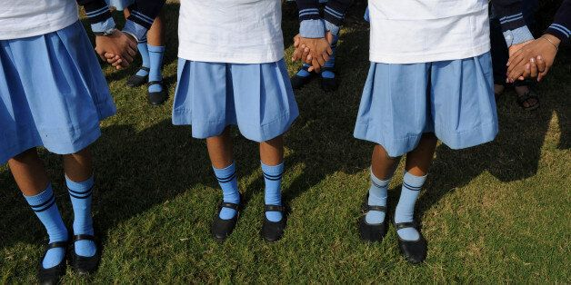 Indian school children hold hands as they make a human chain during a function to mark World Toilet Day in New Delhi on Novem