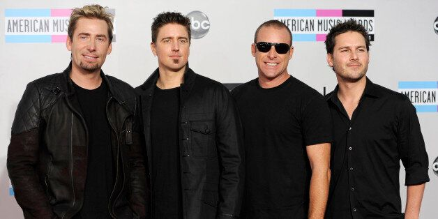 Chad Kroeger, Daniel Adair, Mike Kroeger, and Ryan Peake of the band Nickelback arrives at the 39th Annual American Music Awa
