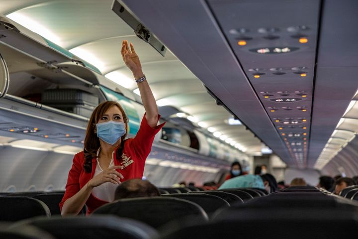 INCHEON, SOUTH KOREA - MARCH 10: A flight attendant is seen wearing a facemask aboard an AirAsia flight bound for Manila, Philippines, at Incheon International Airport on March 10, 2020 in Incheon, South Korea. According to the Korea Centers for Disease Control and Prevention, 131 new cases have been reported, with the death toll rising to 54. The total number of infections in the nation tallies at 7,513. (Photo by Ezra Acayan/Getty Images)