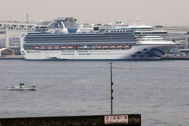 The Diamond Princess cruise ship is anchored at a port in Yokohama, Tuesday, Feb. 25, 2020. Japanese...
