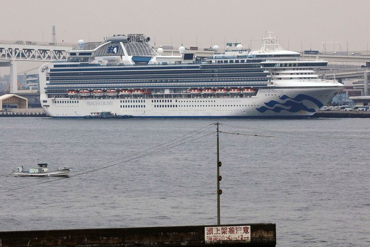 The Diamond Princess cruise ship is anchored at a port in Yokohama, Tuesday, Feb. 25, 2020. Japanese health officials and experts on a government panel acknowledged Monday that the quarantine of the virus-hit cruise ship was not perfect, but defended Japan's decision to release about 1,000 passengers after 14 days.   (Kyodo News via AP)