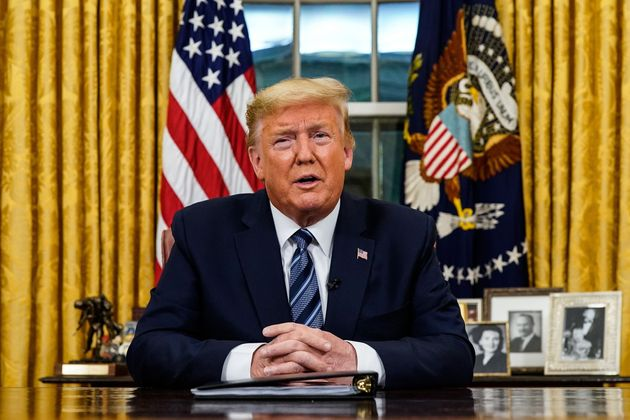 U.S. President Donald Trump addresses the nation from the Oval Office about the widening novel coronavirus...