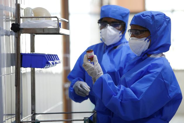 Medical staff with protective clothing are seen inside a ward specialised in receiving any person who...