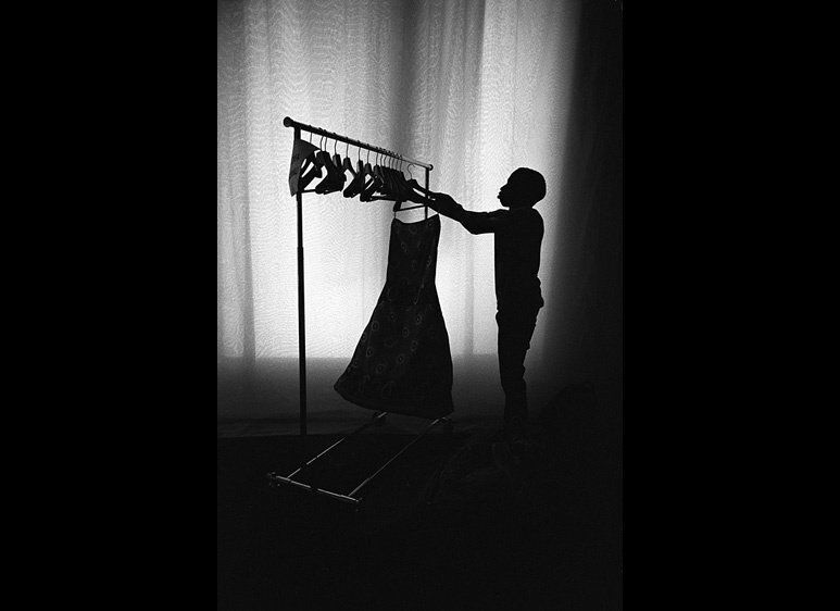 "<a href=""http://www.mikeschreiber.com"" target=""_hplink"">http://www.mikeschreiber.com</a>A dresser getting the clothing ready"