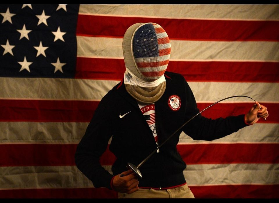 Alexander Massialas of the US Olympic Fencing team poses for pictures during a photo session during the 2012 Team USA Media S
