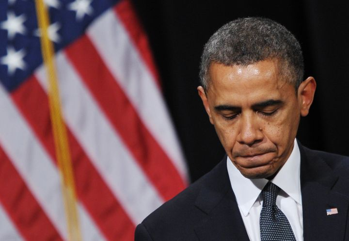 US President Barack Obama pauses as he speaks during a memorial service for the victims and relatives of the Sandy Hook Eleme