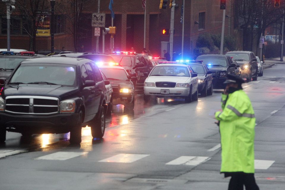 Police cars fill the street outside the New Castle County Courthouse, Monday morning, Feb. 11, 2013 in WiIlmington, Del. , af