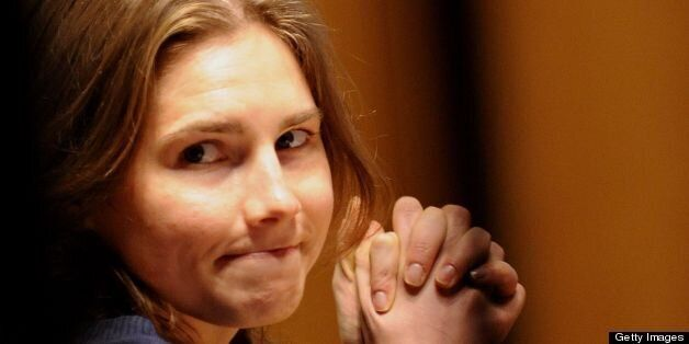 (FILES) This file picture taken on March 12, 2011 shows US Amanda Knox takes place in court before the start of a session of