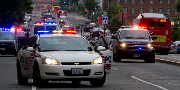 UNITED STATES - Sept 16: Police and firefighters in the background responded to the report of a shooting at the Navy Yard in