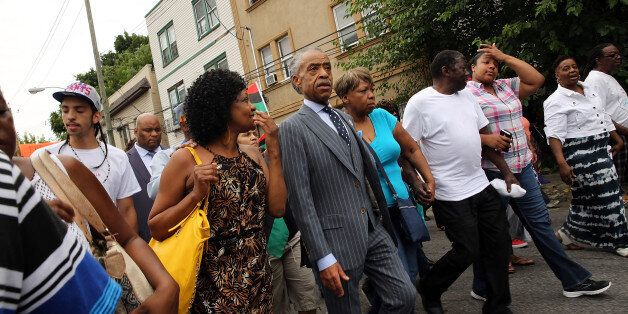 NEW YORK, NY - JULY 19:  The Rev. Al Sharpton marches with family members of Eric Garner (right) and hundreds of others durin