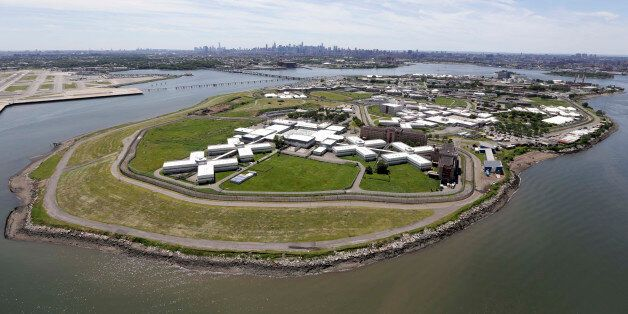 File-This June 20, 2014, file photo shows New York's biggest lockup, Riker's Island jail, with the New York skyline in the ba