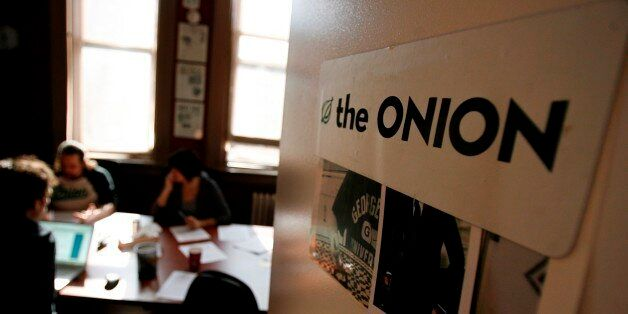 Editors and writers work on copy during a drafts meeting at The Onion offices in New York, Thursday, Oct. 30, 2008.  (AP Phot