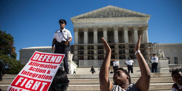 WASHINGTON, DC - OCTOBER 15: Students protest in support of affirmative action, outside the Supreme Court during the hearing of 'Schuette v. Coalition to Defend Affirmative Action' on October 15, 2013 in Washington, DC. The case revolves around affirmative action and whether or not states have the right to ban schools from using race as a consideration in school admissions. (Photo by Andrew Burton/Getty Images)