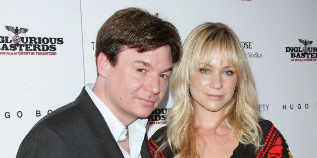 Actor Mike Myers and Kelly Tisdale attend The Cinema Society & Hugo Boss screening of 'Inglourious Basterds' at SVA Theater o