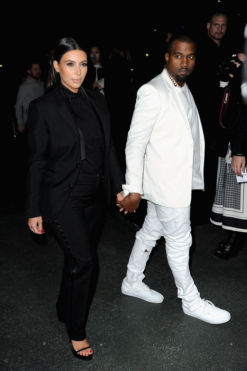PARIS, FRANCE - MARCH 03:  Kim Kardashian and Kanye West attend Givenchy  Fall/Winter 2013 Ready-to-Wear show as part of Pari