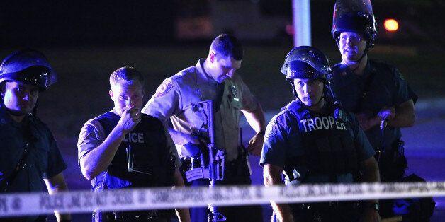 FERGUSON, MO - AUGUST 11:  Police lock down a neighborhood, refusing to let people leave on August 11, 2014 in Ferguson, Miss