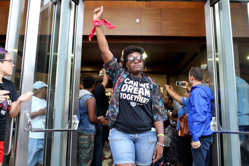 Protesters leave lthe lobby of the James Lawrence King Federal Justice Building where the U.S. Attorneys Office, Southern Dis