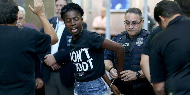 MIAMI, FL - AUGUST 14:  Marie Paul is arrested is arrested by police in the James Lawrence King Federal Justice Building wher