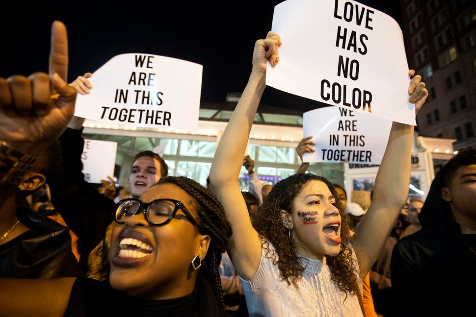 Diamond Nimene, left, and Samaria Muhammad, right, chant with fellow protesters in Atlanta on Thursday during a demonstration