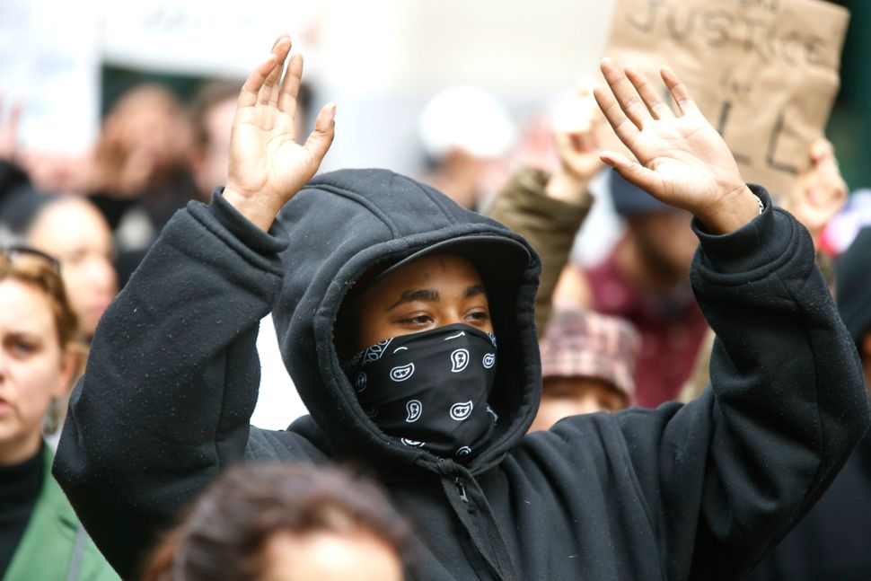 A demonstrator protesting the deaths of two unarmed black men at the hands of white police officers in New York City and Ferg
