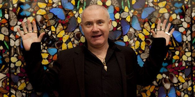 Damien Hirst Poses For Photographers During The Press View Of His Latest Work On Display At The Tate Modern. (Photo by John P