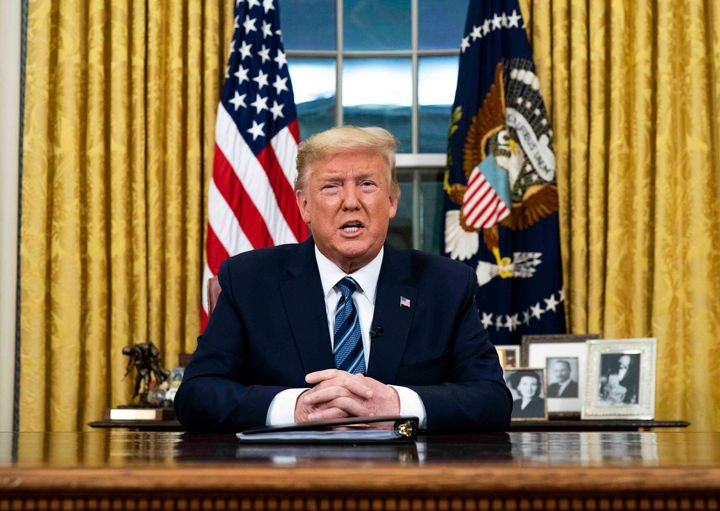 U.S. President Donald Trump addresses the nation from the Oval Office on Wednesday in Washington, D.C. Trump did not include the United Kingdom in his European travel ban.