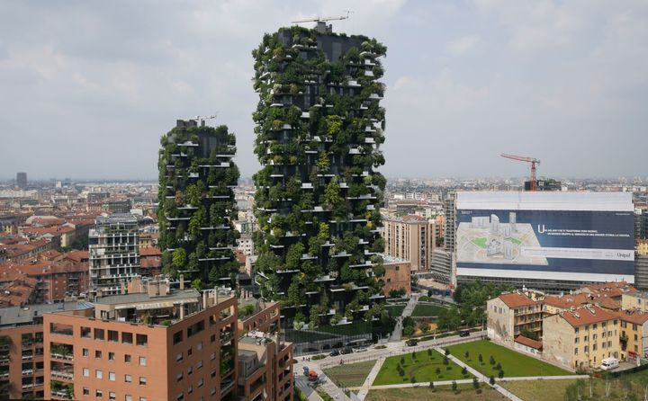 A view of the Bosco Verticale apartment buildings in Milan, Italy, Thurs. May 10, 2018. Italy is suspending mortgage payments during the coronavirus outbreak.