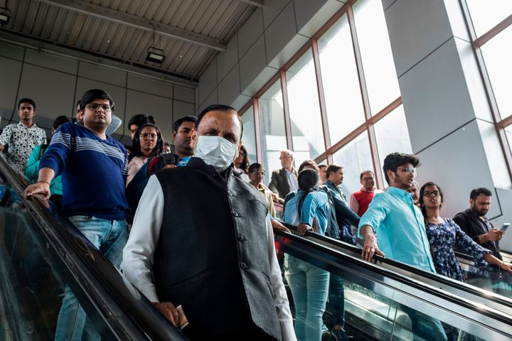 A commuter wearing a face mask as a preventive measure against the spread of the COVID-19 coronavirus at Kashmere Gate station of the Delhi Metro, in New Delhi on March 12, 2020.