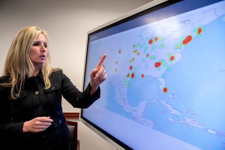 Wendy Woolcok, the special agent in charge of the DEA's special operations division, points to a monitor displaying the local