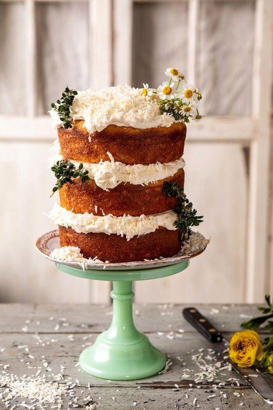 Get the Lemon Coconut Naked Cake With Whipped Vanilla Buttercream recipe from Half Baked Harvest
