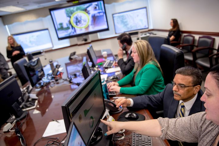 Drug Enforcement Administration agents and intelligence analysts gather information from field operations across the country