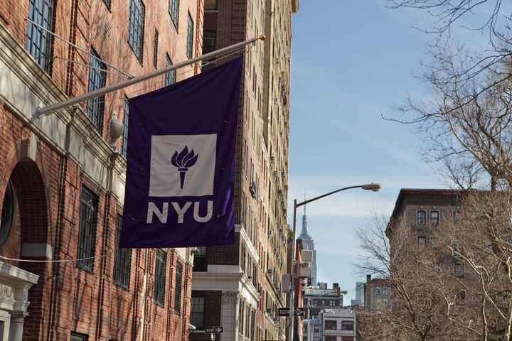 New York, MY, USA - March 22, 2016: New York University buildings on Macdougal Street at 37 Washington Square West. A purple