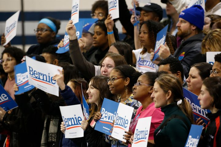 Supporters of Democratic presidential candidate Sen. Bernie Sanders (I-Vt.) hold signs as they listen during a campaign rally