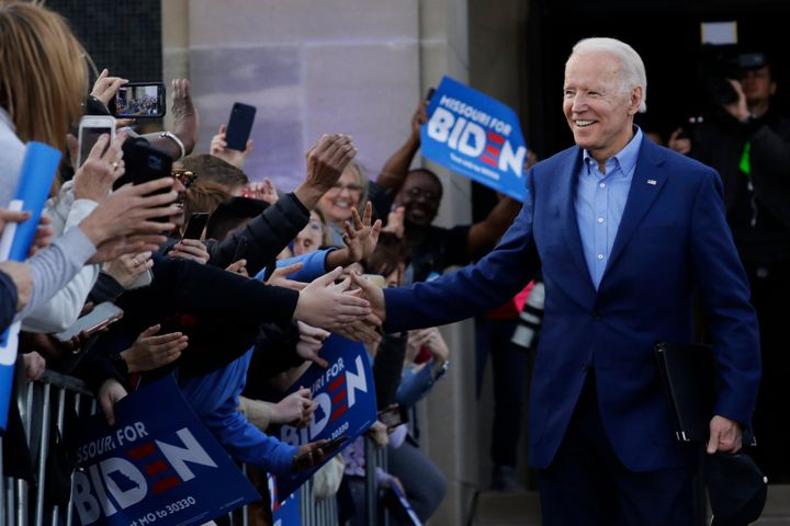 Democratic presidential candidate former Vice President Joe Biden greets the crowd during a campaign rally on March 7 in Kans