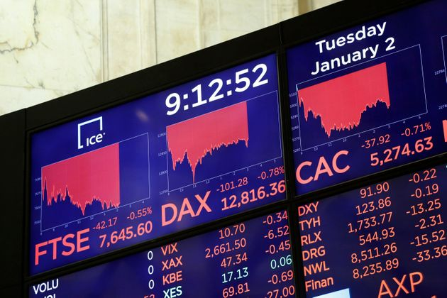Electronic screens display readings for the FTSE, DAX and CAC at the New York Stock