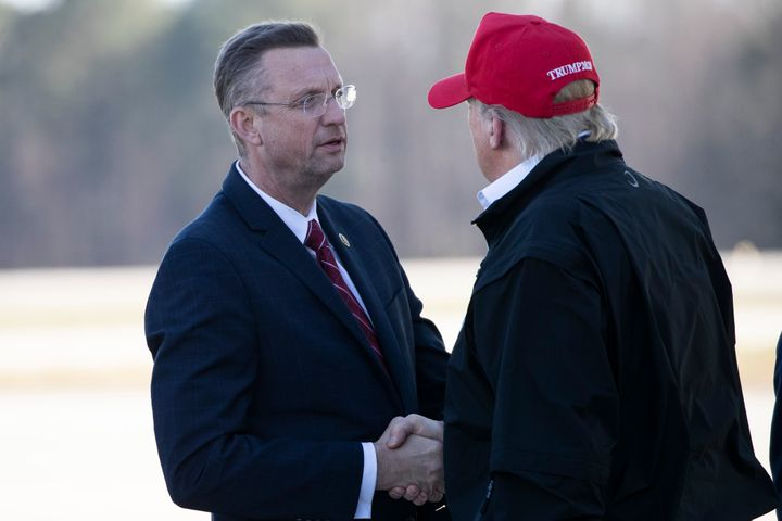 Rep. Doug Collins (R-Ga.) greets President Donald Trump last Friday as Air Force One arrived in Atlanta. Collins later learned that in late February he had come into contact with someone who tested positive for coronavirus.