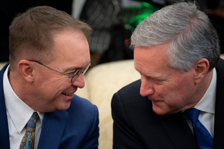 Rep. Mark Meadows (R-N.C.), seen here with outgoing White House chief of staff Mick Mulvaney (left), also had contact with the same person as Collins and Gaetz. Meadows, who is replacing Mulvaney, briefly self-quarantined but tested negative for coronavirus.