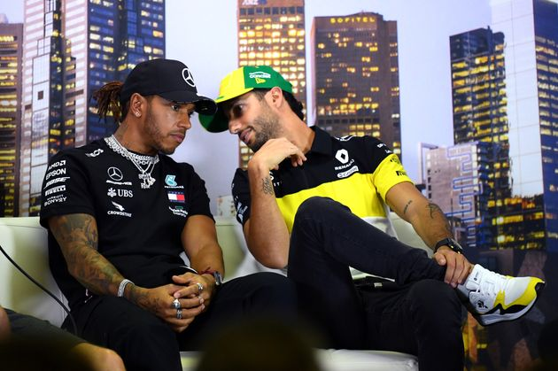 Daniel Ricciardo of Australia and Renault Sport F1 speaks with Lewis Hamilton of Great Britain and Mercedes...
