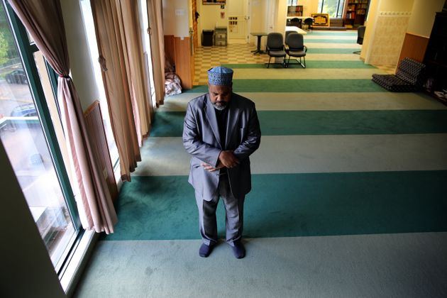 Imam Mohamed Magid prays at the mosque of All Dulles Area Muslim Society (ADAMS) in Sterling, Virginia,...