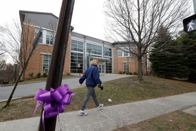 A woman walks past the Young Israel orthodox synagogue during the coronavirus outbreak in New Rochelle,...