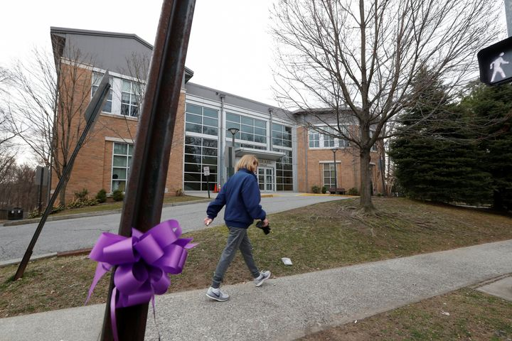 A woman walks past the Young Israel orthodox synagogue during the coronavirus outbreak in New Rochelle, New York, on March 12