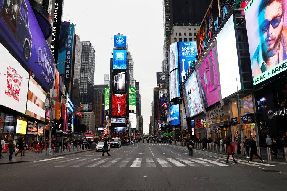 A nearly empty 7th Avenue in Times Square is seen at rush hour after it was announced that Broadway shows...