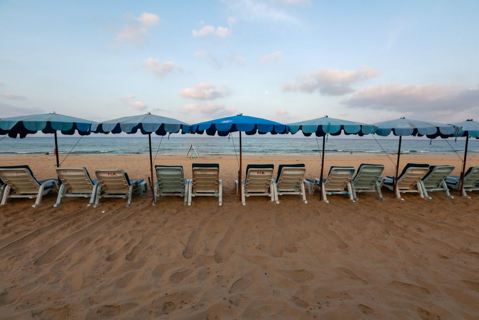 Empty chairs are seen on a beach which is usually full of tourists, amid fear of coronavirus in