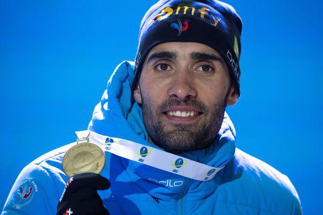 Martin Fourcade, ici célébrant son titre de champion du monde à Rasen-Antholz en...