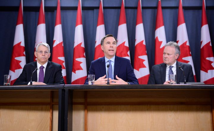 Superintendent of Financial Institutions Jeremy Rudin, left to right, Finance Minister Bill Morneau, and Bank of Canada Governor Stephen Poloz take part in a press conference at the National Press Theatre in Ottawa on March 13, 2020.