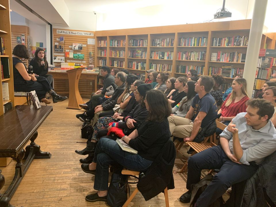 Kate Elizabeth Russell talks to an audience at Greenlight Bookstore in