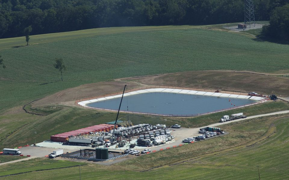 A pit containing fresh water or fresh water with chemicals sits next to a drill site in Butler County,